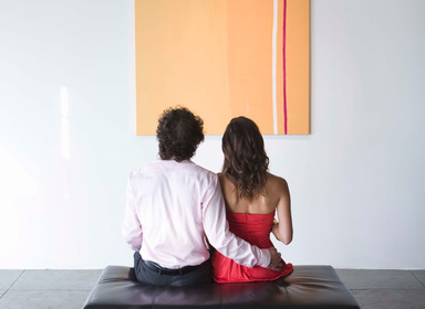 couple looking at art on wall